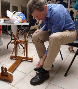 John tries out a spinning wheel